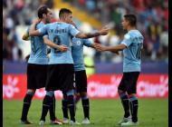 Jugadores uruguayos celebran su triunfo ante la Selección de Jamaica.