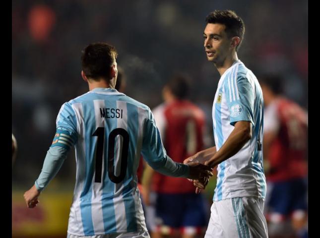 Javier Pastore y Lionel Messi.