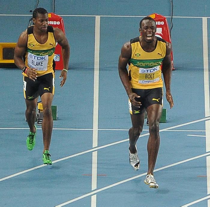 Yohan Blake y Usain Bolt.