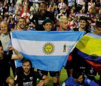 Jugadores del Huesca celebran el ascenso a Primera División tras ganar al Lugo por 0-2 en el partido de Liga de Segunda División.