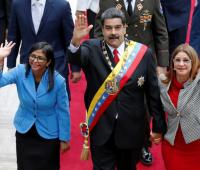 Delcy Rodríguez, Nicolás Maduro y Cilia Flores.