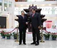 Hu Huaibang y Nicolás Maduro