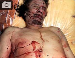 El cuerpo de Muamar al Gadafi muerto en Sirte