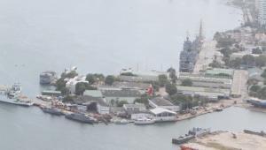La posible venta a particulares del terreno donde se encuentra la Base Naval, y donde se podrían construir edificios altos debido a que no hay un Plan Especial de Manejo y protección del patrimonio, es una de los motivos por los cuales se afectaría el título.