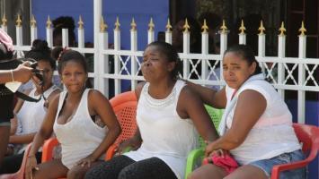 Parientes de John Recuero, a quien mataron en Henequen en medio de enfrentamiento entre comunidad y policías que llegaron a apagar picó.