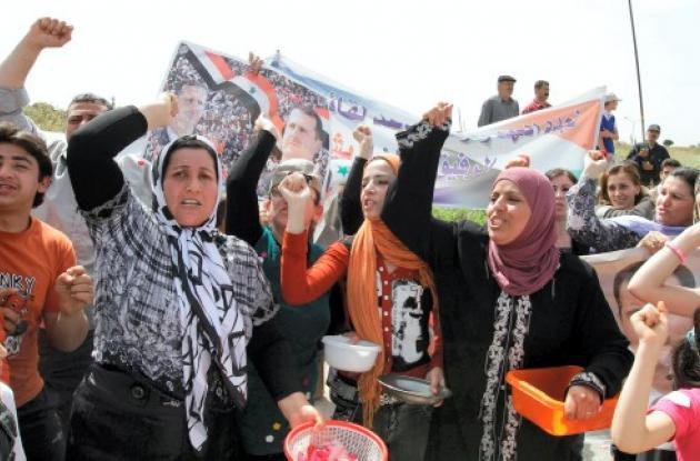 Mujeres protestando en Siria