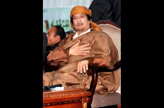 Muamar Kadhafi.