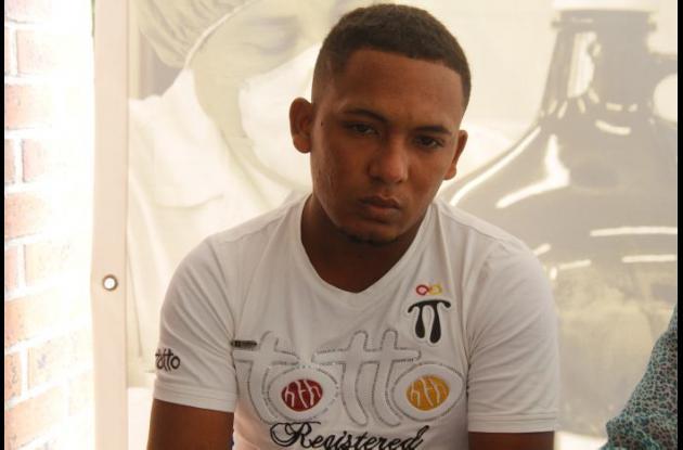 Luis, hijo de Sergio Contreras, mototaxista asesinado de un balazo en riña, en Olaya Herrera.