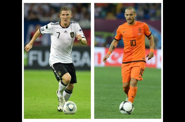 El alemán Bastian Schweinsteiger y el holandés Wesley Sneijder.