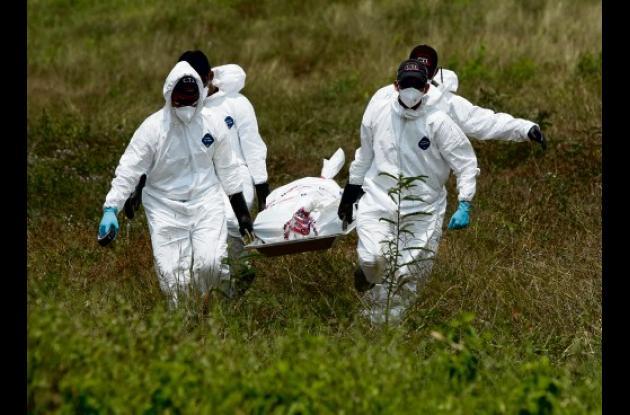 El cuerpo fue hallado en un lote enmontado