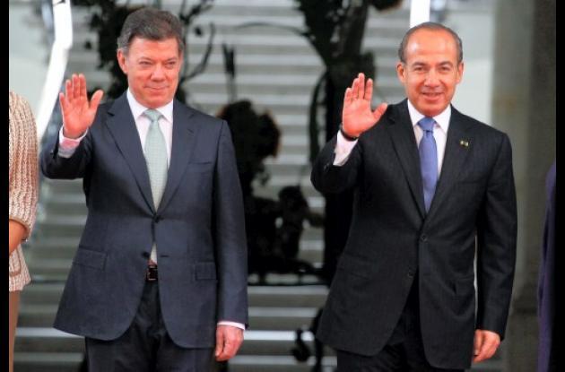 Juan Manuel santos y Felipe Calderón, presidentes de Colombia y México respectiv