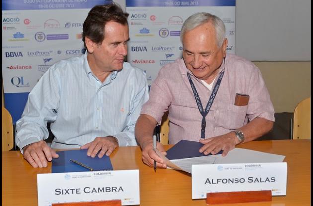 Sixte Cambra i Sànchez,presidente del Puerto de Barcelona, y Alfonso Salas Trujillo, gerente general de la Sociedad Portuaria de Cartagena.